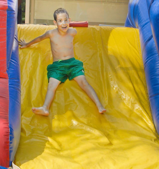 How An Inflatable Water Slide Could Be The Answer To Your Summer Party Needs